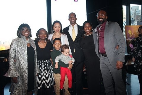 Audrey poses with proud family (l-r) Marilyn Mosley, Dr. Janice Carrero Mosley, Assemblyman Walter T. Mosley III, Sameita Jennings, Dr. James Jennings (front) Sebby Carrero Mosley, Ally Eh-Suk Mosley